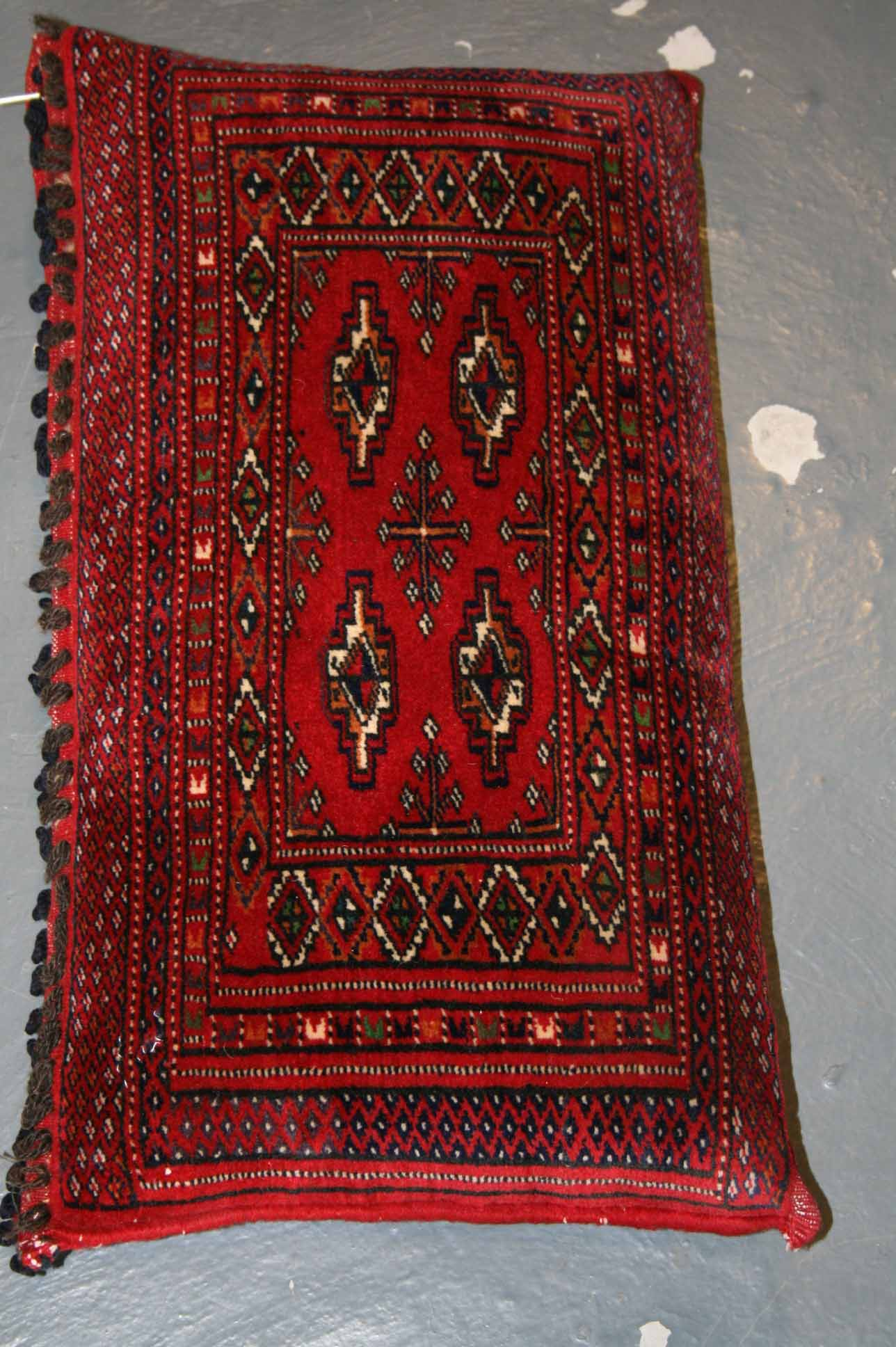 One of a pair of Turkmen rugs made into a hard cushion
