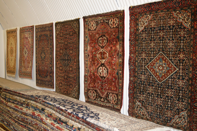 Rugs stacked inside Little-Persia