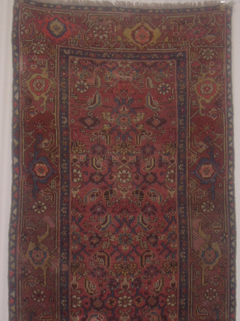 An antique Malayer rug able to add character to any room