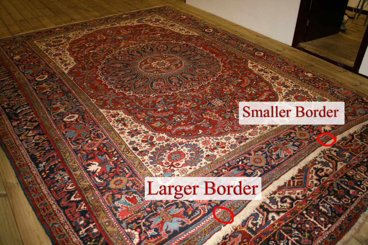 Heriz Rug on floor showing different widths of borders