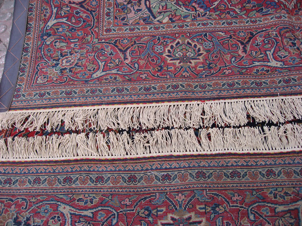 Kashan rug fringe at back