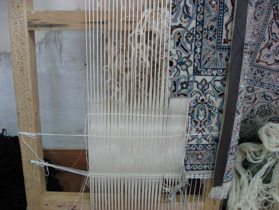 Nain rug on loom for repair