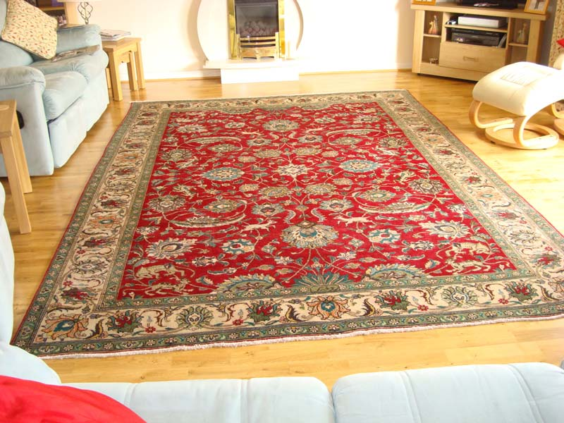 Traditional Tabriz adding life and character to this living room