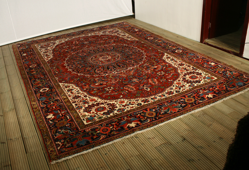 Heriz rug after border repair