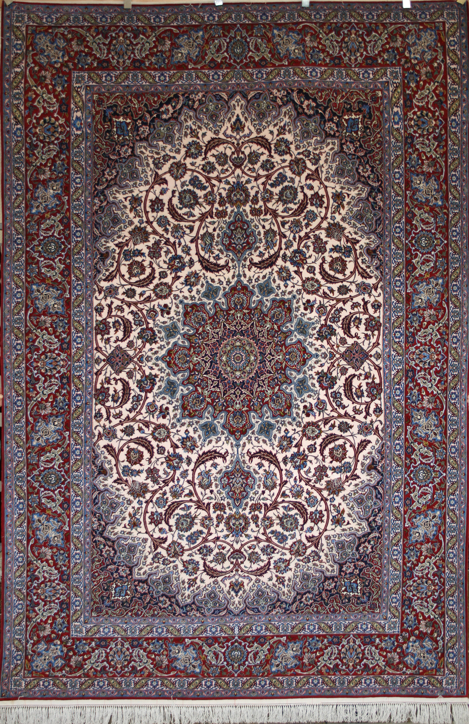 A fine Isfahan rug with a traditional central medallion pattern and colouring